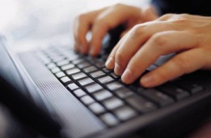man-typing-laptop